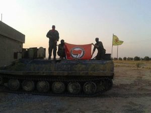 "Flag of ""Antifascistiche Aktion"" held up by YPG volunteers. (Source: It's Going Down)"