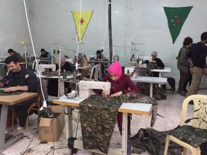 A sewing cooperative in Rojava cmoposed primarily of women. (Source: Wikimedia Commons)