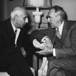 Secretary Dean Acheson (right) confers with Prime Minister Mohammed Mossadegh of Iran (left) in Washington D.C.