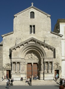 St. Trophime, facade showing rounded arch and tympanum sculptures. 1180.  Romanesque architecture.