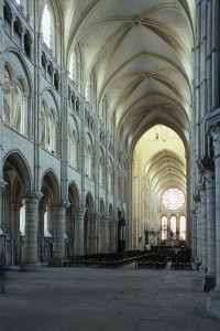 Amiens Cathedral, interior showing nave, vaulted ceiling, and stained glass window. 1218-1247.  Gothic architecture.