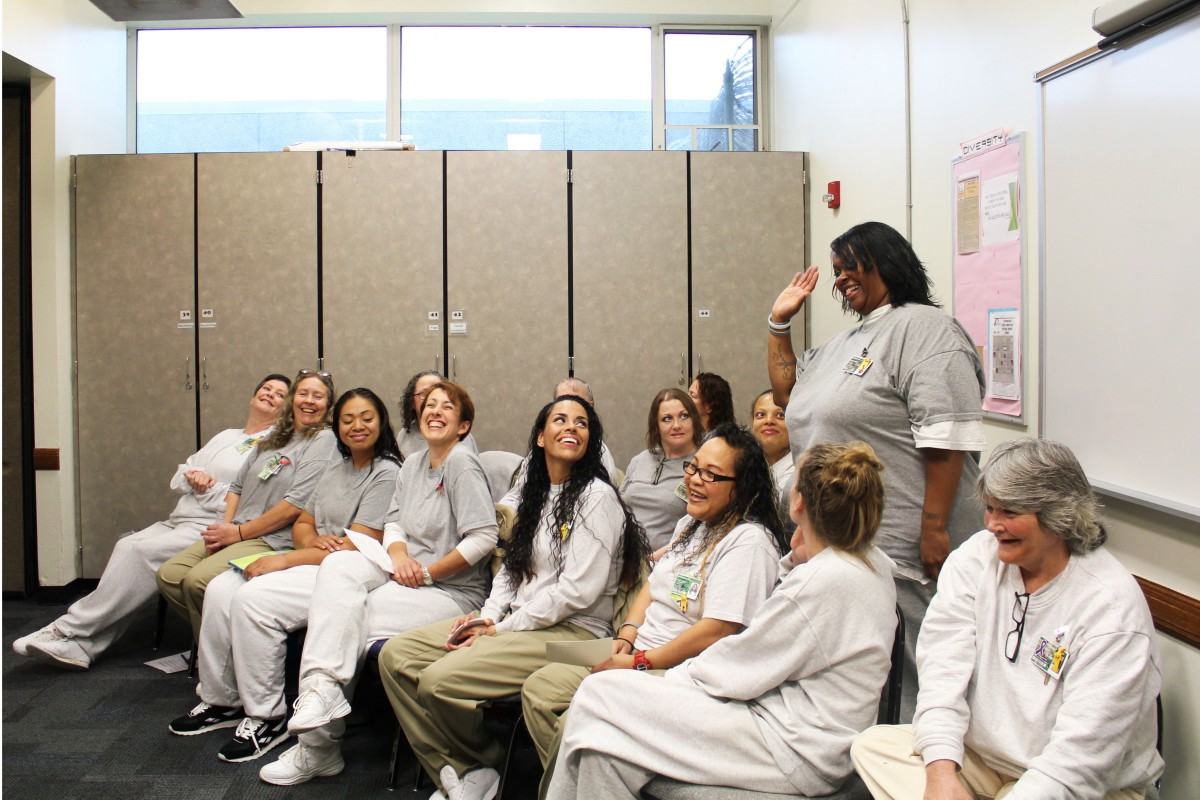 Nine of WA's 12 prisons host Roots of Success, an environmental literacy class; here, Washington Corrections Center for Women celebrates its first class of graduates. The two class instructors (furthest left in the photo) are also incarcerated, and were certified to teach the class by the curriculum's creater, Dr. Raquel Pinderhughes of University of San Francisco. Photo by Evergreen graduate Joslyn Rose Trivett.