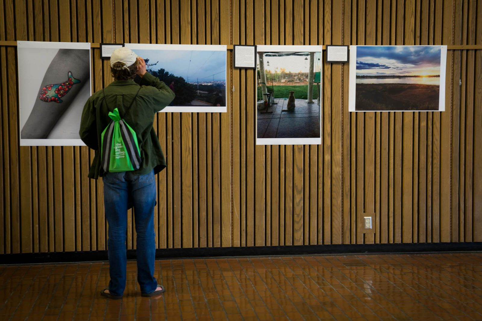 Student checks out TRiO's  photo voice project.
