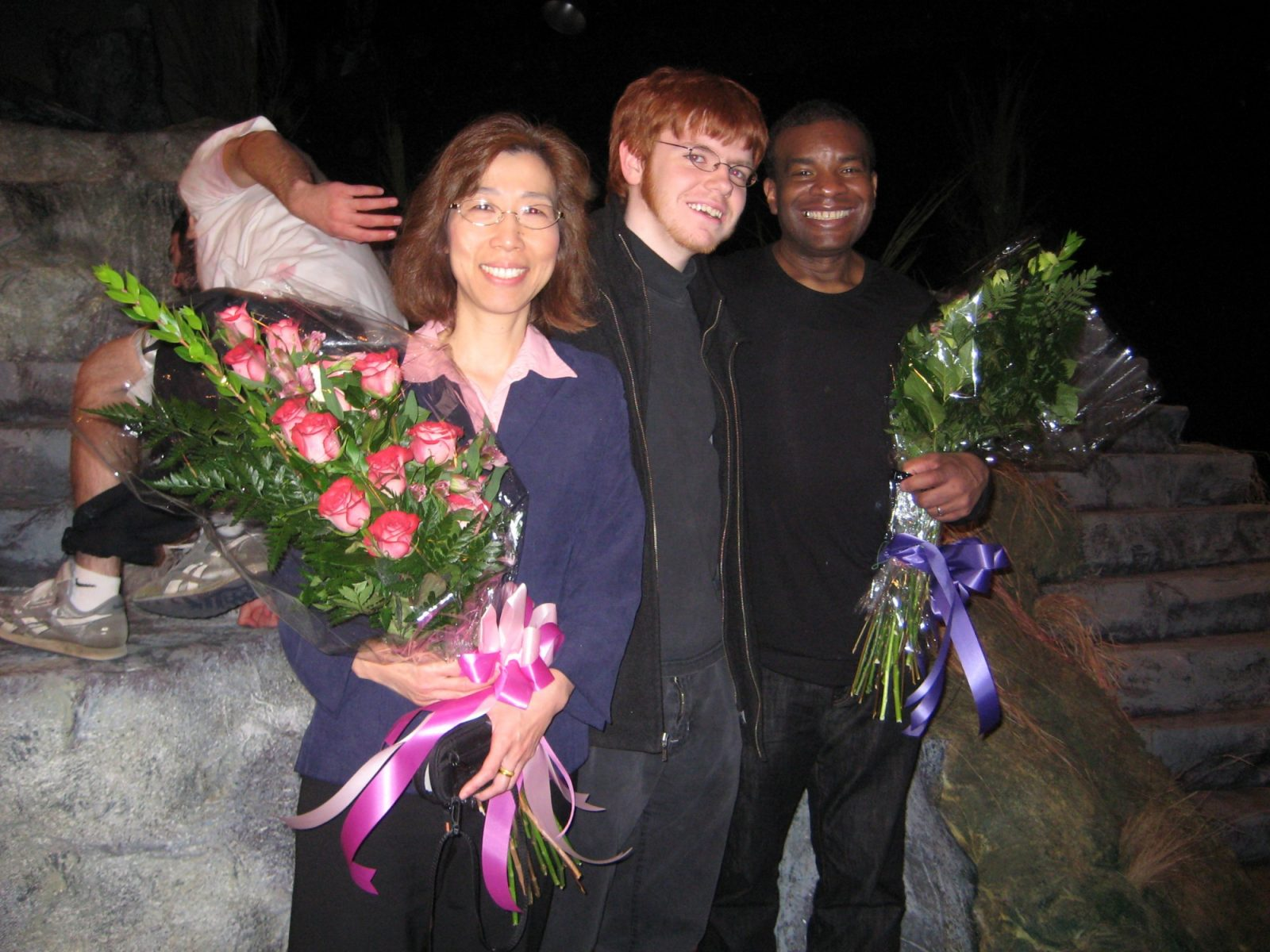"This photo was taken at the end of the final performance of The Bacchae of Euripides by Wole Soyinka, a dance-heavy production presented by the program ""Me and My Shadow: Performing Arts in Society"" on March 15, 2008, at the Experimental Theatre. Kabby, seen here with the director Rose Jang and student stage manager Corey Crowley, choreographed and taught all the dances by mixing Ballet, modern dance, Hip Hop, and African dance style together. Contributed by Rose Jang"