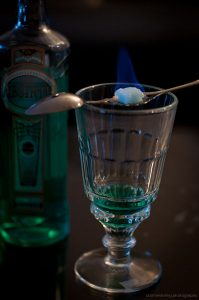 Glass of absinthe with sugar cube on spoon